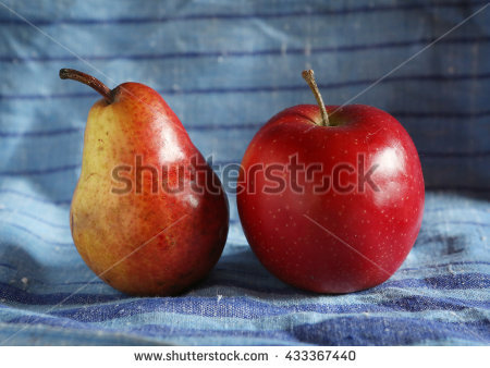 stock-photo-pear-and-apple-on-blue-cloth-background-433367440